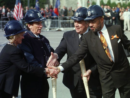 Detroit Mayor Dennis Archer and Gov. John Engler shake the hands with Marian and Mike Ilitch during groundbreaking ceremonies at the site of the new Tigers stadium in Detroit, Wednesday, Oct. 29, 1997.