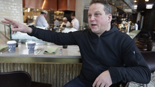 Chef Paul Kahan sits at his restaurant Nico Osteria in Chicago.