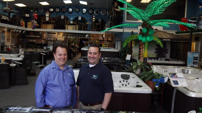 Steven Metz and Michael Metz, co-owners of Central Jersey Pools, a 58-year-old third-generation supplier of pools and outdoor living accoutrements, stand inside their Freehold Township showroom.