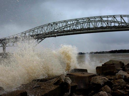 Large waves crash against the seawall at International
