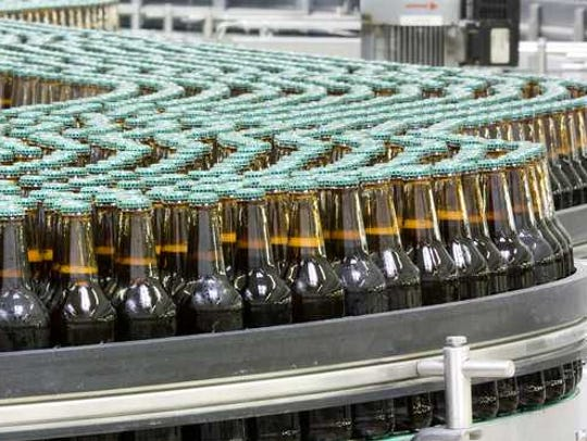 Bottled beverages on a conveyor belt.
