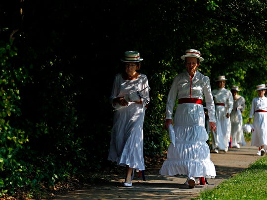 Members of the Midtown Victorian Ladies Drill Team arrive at the staging grounds of the Old Fashioned Fourth of July Parade in 2015.