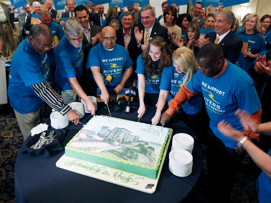Supporters of the proposed Rivers Casino and Resort at Mohawk Harbor in Schenectady cut a cake during a news conference as a public meeting on casinos was being held in a nearby conference room, on Monday in Albany. Supporters and critics of proposals for an Albany area casino are weighing in as three days of public hearings on casinos planned for upstate New York get underway.