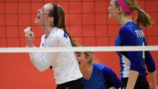 Green Bay Notre Dame senior Maureen Schick reacts after the Tritons scored a point against Wrightstown during a WIAA Division 2 sectional semifinal match Thursday at Seymour. Schick leads Notre Dame with 561 digs.