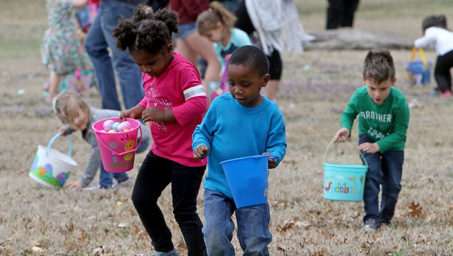 Anaiyah and Armanti Robertson pick up eggs Saturday, March 17, 2018, at the Wichita Falls Parks and Recreation Annual Easter Egg Hunt in Lucy Park.