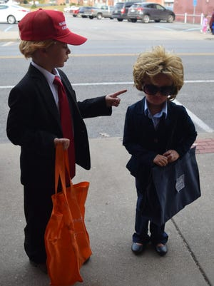 With the then upcoming election, Landon and Malia French pose as Donald Trump and Hilary Clinton.