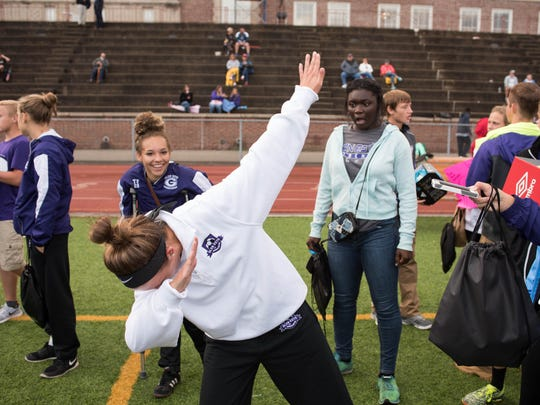 The Glen Este and Withrow kids horse around at the Tigers' girls soccer game day.