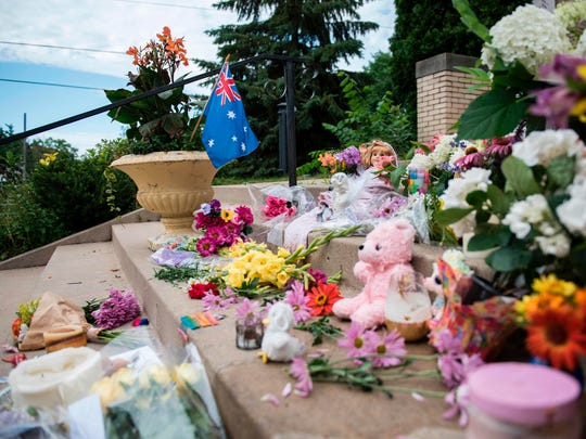 Flowers and signs memorializing Justine Damond are
