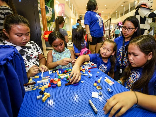 Kids create a mini city with plastic building blocks during the 11th annual Autism Awareness Fair at the Agana Shopping Center on Satruday, April 14, 2018.