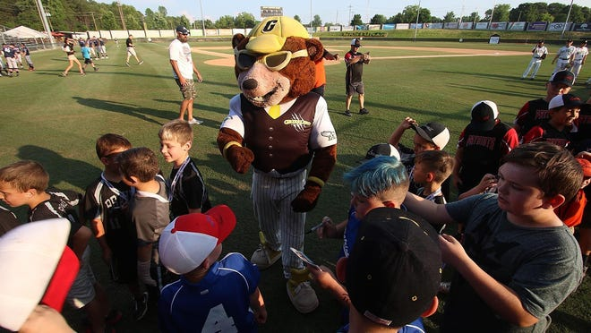 The Gastonia Grizzlies mascot, 'Chizzle,' greets young fans at the home season opening game last May in this Gazette file photo. The future of the Grizzlies in Gastonia may be in doubt after next season if the city of Gastonia gives management of a new FUSE stadium to another group.