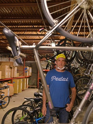 Peter Howard of Barney's Bicycles  on Wednesday with 75 bikes in need of repair that came in over the last few weeks.