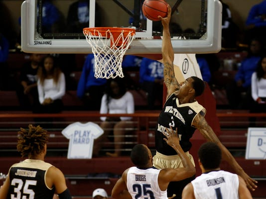Western Michigan's Josh Davis dunks against Villanova during the second half of an NCAA college basketball game at the Charleston Classic at TD Arena, Thursday Nov. 17, 2016, in Charleston, S.C. (AP Photo/Mic Smith)