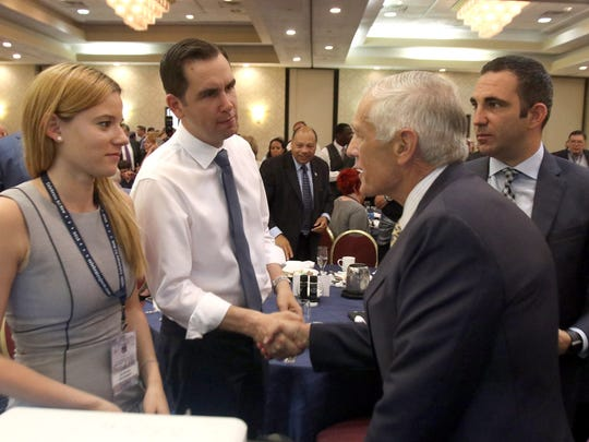 Retired General and former Presidential candidate Wesley Clark (right) shakes hands with Jersey City Mayor Steven Fulop after he spoke to NJ Delegates to the Democratic National Convention at the Airport Rennaissance Hotel in Tinicum Township, PA, Tuesday, July 26, 2016.