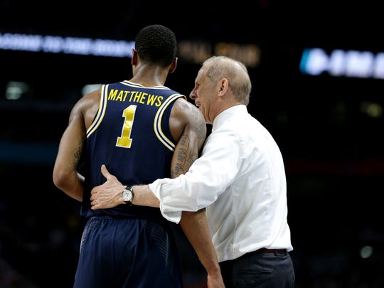 Michigan coach John Beilein instructs Charles Matthews