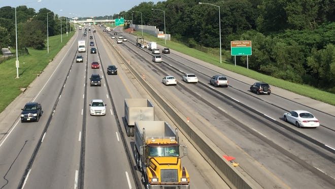 Iowa motorists are paying a dime more for state taxes at the gas pump, but they are driving more than last year. This is traffic on Interstate Highway 235 in Des Moines.