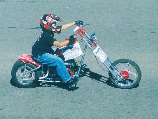 Blayne Maldonado leads the parade at the annual Golden Aspen Motorcycle Rally in 2003.