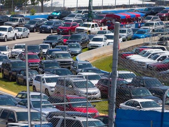Cars are parked on the Milwaukee Mile on Aug. 8, 2017,