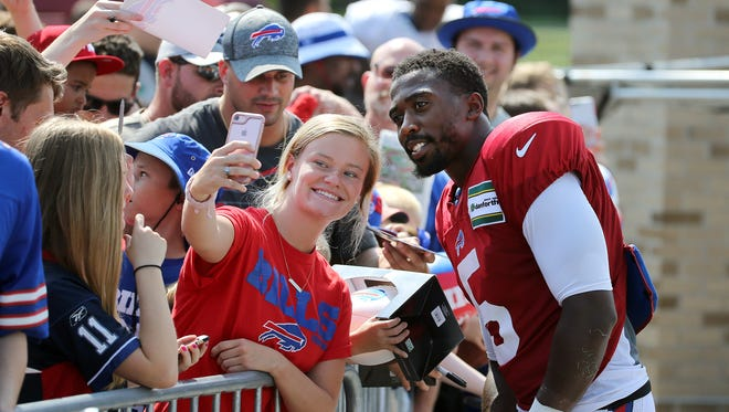 Bills quarterback Tyrod Taylor stops for a selfie with a fan after practice.