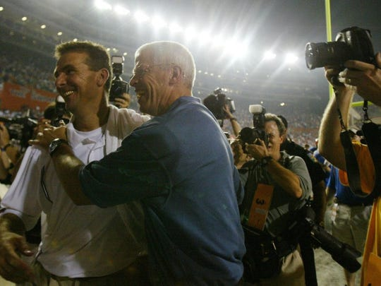 utfla7.cc#4340.jpg------sports-----Florida's Urban Meyer gets a hug from the Florida Athletic Director Jeremy Foley after defeating Tennessee Saturday at Gainesville. Florida defeated the Vols 16-7. Photo by Cathy Clarke, Knoxville News Sentinel 09/17/05