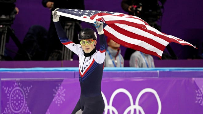 John-Henry Krueger of the USA celebrates his silver medal in the 1,000 meters in short-track speedskating.