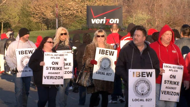 Verizon workers, seen here on the picket line in April, have approved their new contract.