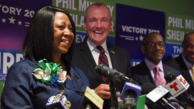 Sheila Oliver in front of an overflow crowd, standing beside Phil Murphy after she was announced in July as his lieutenant governor running mate during a press conference in Newark.