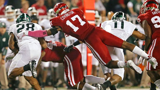 Chris Covington, a 6-2, 230-pound senior, will fill Marcus Oliver's role this season. Oliver was  perhaps the most productive middle linebacker in IU history. Last season, Covington (17) went airborne against  Michigan State Spartans running back Madre London.