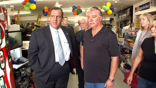 New Jersey Gov. Chris Christie meets with East Dover Marina owner Rick Wietzel during a stop Wednesday in Toms River, N.J., on the second anniversary of Superstorm Sandy.