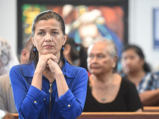 Parishioners attend a Mass in honor of Guam's World