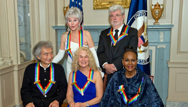 The five recipients of the 38th Annual Kennedy Center Honors pose for a group photo following a dinner hosted by U.S. Secretary of State John Kerry at the US Department of State in Washington, DC.