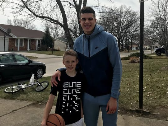 Michael Porter Jr. poses for a photo with Daniel Dee Wampler
