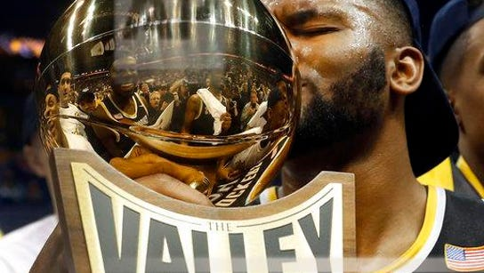 Wichita State's Shaquille Morris kisses the trophy