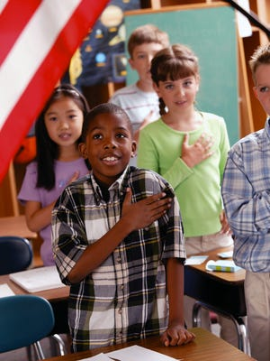 Students recite the Pledge of Allegiance. A state law passed this spring mandates that language informing parents of their rights concerning the Pledge of Allegiance must be included directly in the student handbook.