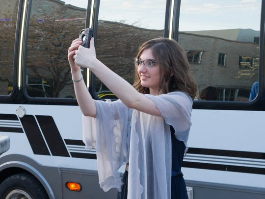 Laura Green, a student at Central High, takes a selfie before attending the 2018 Circle K Special Education Prom held at the University of Evansville Friday.