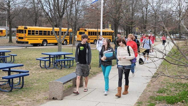 Severna Park High School students arrive for class in this March 2012 photo.  Severna Park and other public high schools in  Anne Arundel County, Md., start classes at 7:17 a.m. A task force is examining options for delaying that start time.