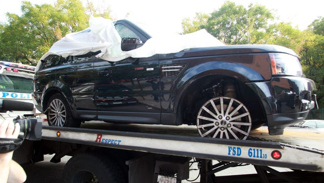 The Range Rover involved in the bikers attack is being moved from the police precinct for further police investigation Saturday in New York.