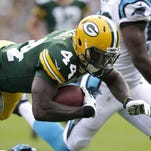 Green Bay Packers running back James Starks dives for a touchdown.