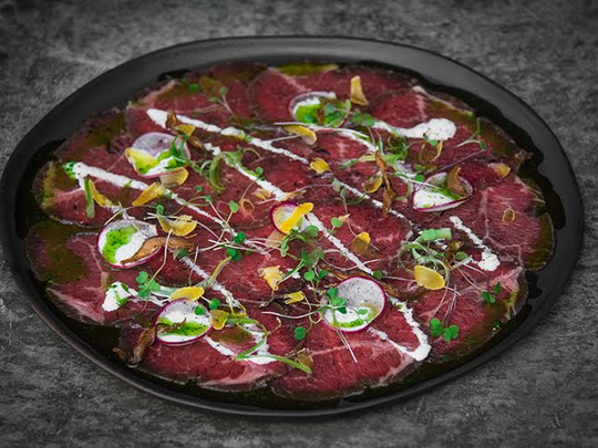 Smoked Wagyu carpaccio with cured egg yolks, charred