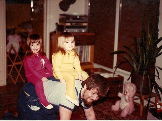 Jeff Brown with twin daughters from left Sarah Brown