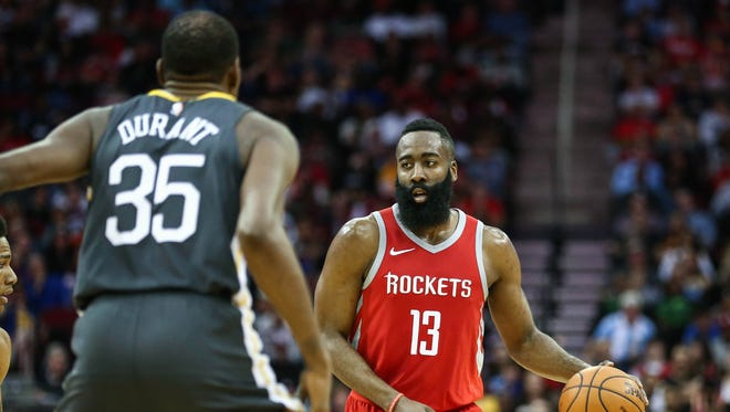 Houston Rockets guard James Harden (13) dribbles the ball during the game against the Golden State Warriors at Toyota Center.
