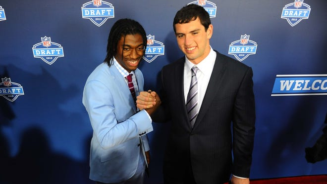 Andrew Luck and Robert Griffin III, here at the 2012 Draft, have seen their careers veer in opposite directions after both enjoyed standout rookie seasons.