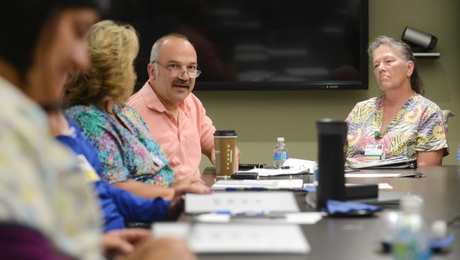 No One Dies Alone program volunteer Tim Senko talks about the Genesis program during a recent training session. No One Dies Alone volunteers will spend time with people nearing death in the hospital who have no one with them.