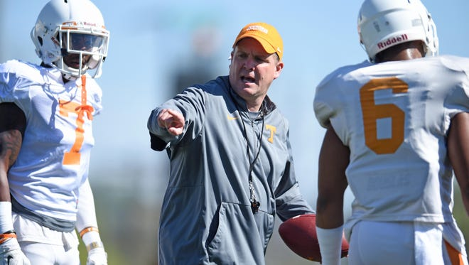 Tennessee defensive coordinator Bob Shoop, center, instructs Tennessee safeties Rashaan Gaulden (7) and Todd Kelly Jr. (6) during spring practice at Haslam Field on Tuesday, March 29, 2016.