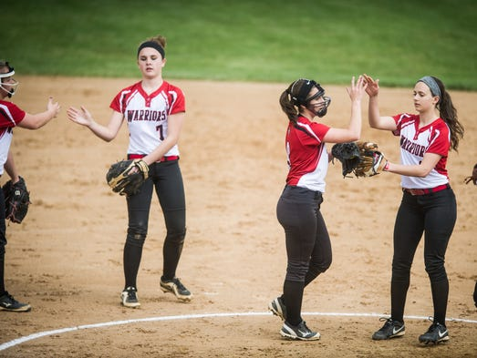 Susquehannock pitcher Madison Staub (8), center, high-fives