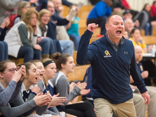 Greencastle's coach Michael Rhine cheers on his team