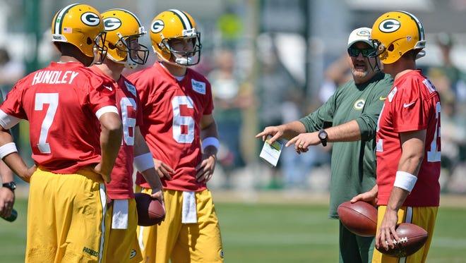 From left, Green Bay Packers quarterbacks Brett Hundley (7), Scott Tolzien (16), Matt Blanchard (6) and Aaron Rodgers (12) talk with coach Alex Van Pelt during minicamp at Clarke Hinkle Field in June.