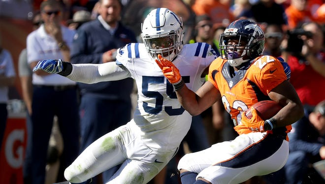 Indianapolis Colts inside linebacker Sio Moore (55) misses a tackle by the spin move by Denver Broncos running back C.J. Anderson (22). The Denver Broncos host the Indianapolis Colts in their NFL football game Sunday, September 18, 2016, at Sports Authority Field at Mile High in Denver CO.