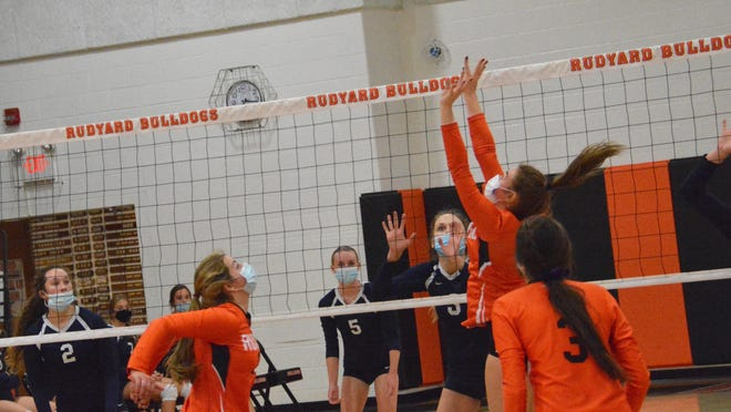 Rudyard's Chesney Molina (12) sets during a Straits Area Conference match against Sault High Tuesday night.