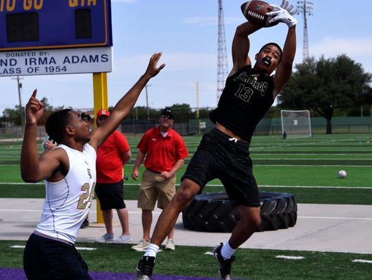 Abilene High's Jacoby Booker tries to catch an end zone pass during a seven-on-seven touch football game against Lubbock Coronado Friday at Hardin-Simmons University.