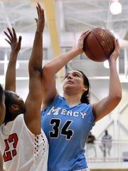 Mercy center Danielle Feldkamp (34) attempts a shot